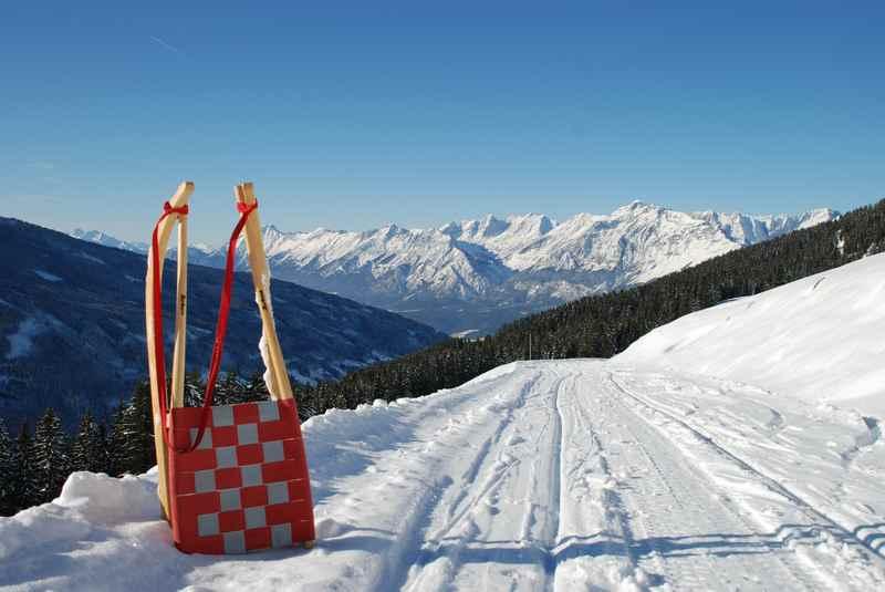 Rodelbahn Karwendel - Durch die verschneite Winterlandschaft rodeln und das Panorama auf die Berge im Karwendel geniessen